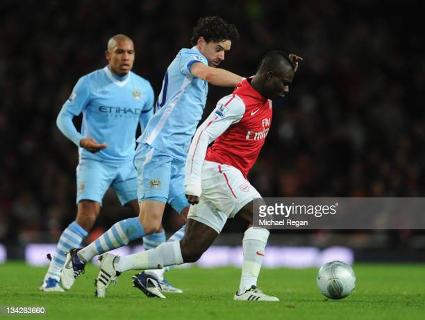 Emmanuel Frimpong of Arsenal holds off Owen Hargreaves of Manchester City during the Carling Cup Quarter Final match between Arsenal and Manchester...