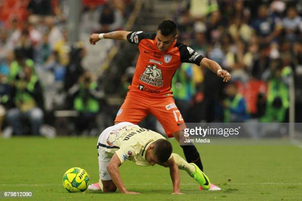 Emmanuel Garcia of Pachuca fights for the ball with Diego Lainez of America during the 17th round match between America and Pachuca as part of the...