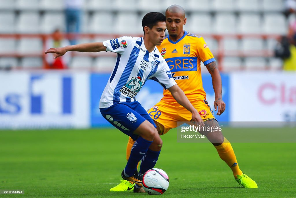 Emmanuel Garcia of Pachuca struggles for the ball with Luis Rodriguez of Tigres during the 4th round match between Pachuca and Tigres UANL as part of the Torneo Apertura 2017 Liga MX at Hidalgo Stadium on August 12, 2017 in Pachuca, Mexico.