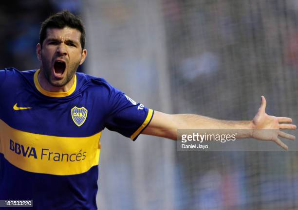 Emmanuel Gigliotti, of Boca Juniors, celebrates after scoring during a match between Boca Juniors and Quilmes as part of the Torneo Inicial 2013 at...