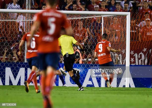Emmanuel Gigliotti of Indendiente kicks the ball to score the first goal of his team during the first leg of the Copa Sudamericana 2017 final between...