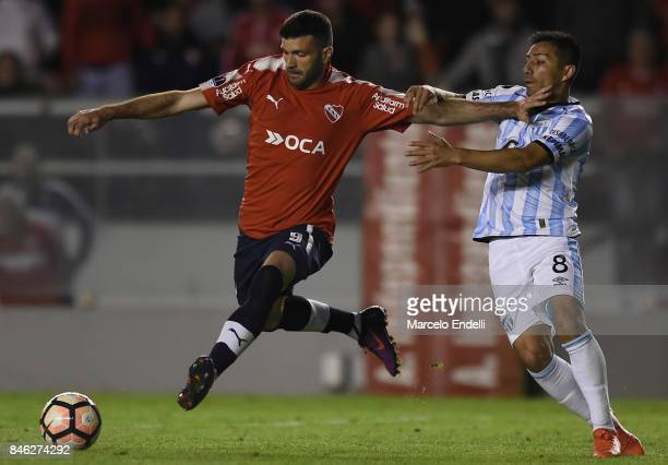 Emmanuel Gigliotti of Independiente fights for ball with Guillermo Acosta of Atletico Tucuman during a second leg match between Independiente and...