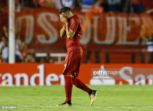 Emmanuel Gigliotti of Independiente leaves the pitch after being sent off during the first leg match between Independiente and Gremio as part of...