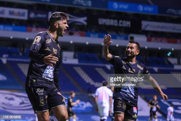 Emmanuel Gigliotti of Leon celebrates the first scored goal of Leon during the 15th round match between Puebla and Leon as part of the Torneo...