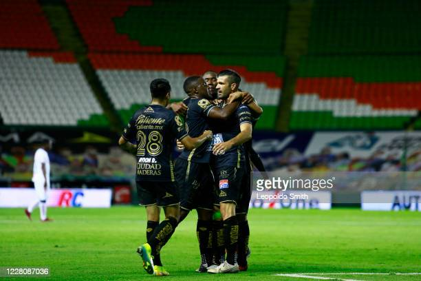 Emmanuel Gigliotti of Leon celebrates with teammates after scoring the second goal of his team during the 5th round match between Leon and Tijuana as...