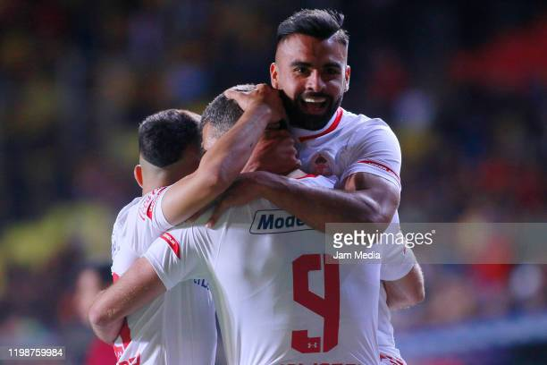 Emmanuel Gigliotti of Toluca celebrates with teammates after scoring the first goal of his team during the 1st round match between Morelia and Toluca...