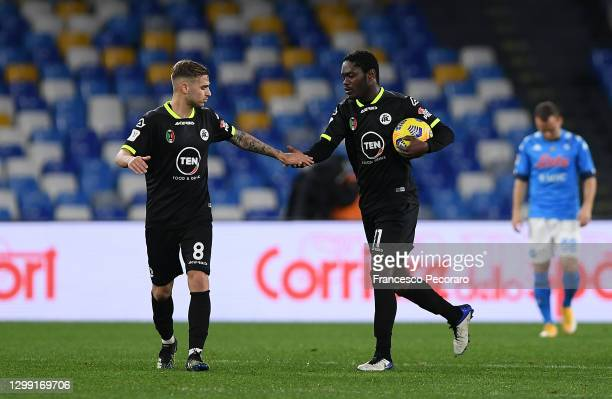 Emmanuel Gyasi of Spezia celebrates with Matteo Ricci of Spezia after he scores his sides 1st goal during the Coppa Italia match between SSC Napoli...
