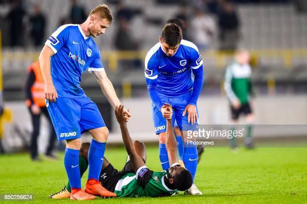 Emmanuel Imorou of Cercle Brugge is dejected after losing and is helped by Ruslan Malinovskyi midfielder of KRC Genk and Jakub Brabec defender of KRC...
