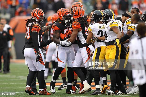 Emmanuel Lamur of the Cincinnati Bengals holds back Vontaze Burfict of the Cincinnati Bengals while he argues with members of the Pittsburgh Steelers...