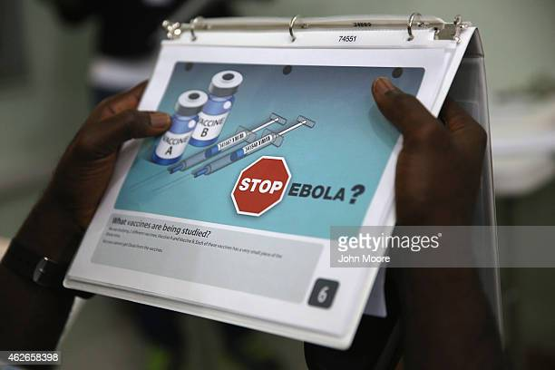 Emmanuel Lansana takes part in a briefing before becoming the first person to be injected in the Ebola vaccine trials which were launched at...