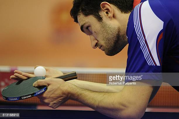 Emmanuel Lebesson of France competes against Anton Kallberg of Sweden during the 2016 World Table Tennis Championship Men's Team Division Round 4...