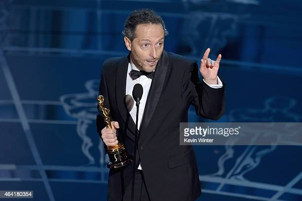 """Emmanuel Lubezki accepts the Best Cinematogrphy Award for """"Birdman"""" onstage during the 87th Annual Academy Awards at Dolby Theatre on February 22,..."""