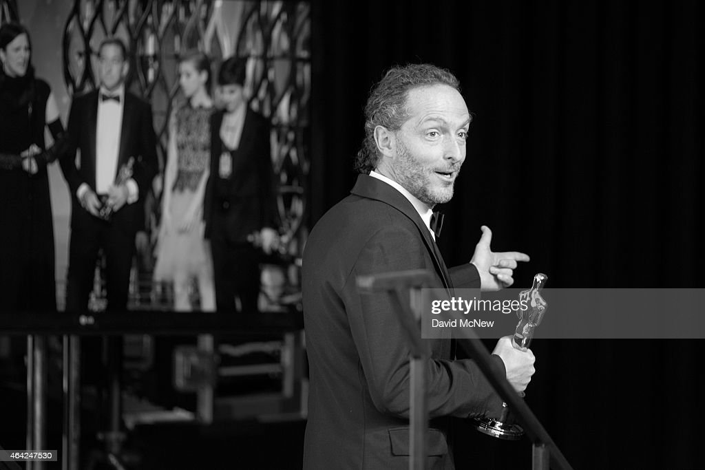 Emmanuel Lubezki winner of the Best Cinematography Award for 'Birdman' leaves the press photo room at the 87th Annual Academy Awards at Dolby Theatre, February 22, 2015 in Hollywood, California.