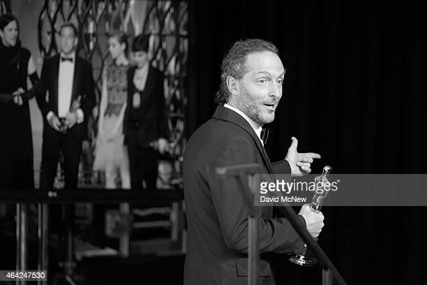 Emmanuel Lubezki winner of the Best Cinematography Award for 'Birdman' leaves the press photo room at the 87th Annual Academy Awards at Dolby...