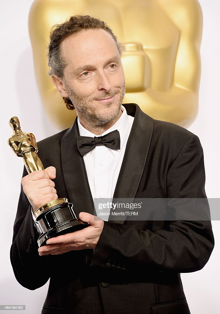 Emmanuel Lubezki winner of the Best Cinematogrphy Award for 'Birdman' poses in the press room during the 87th Annual Academy Awards at Loews Hollywood Hotel on February 22, 2015 in Hollywood, California.
