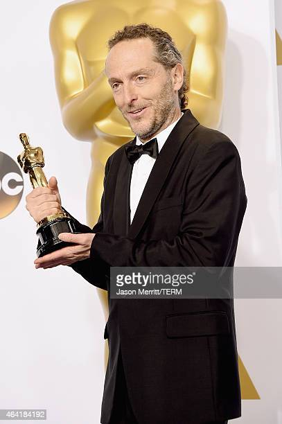 Emmanuel Lubezki winner of the Best Cinematogrphy Award for 'Birdman' poses in the press room during the 87th Annual Academy Awards at Loews...