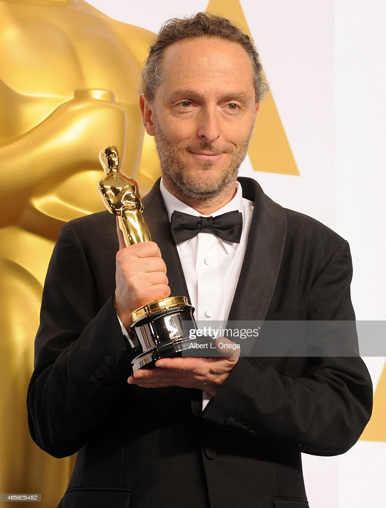 Emmanuel Lubezki winner of the Best Cinematogrphy Award for 'Birdman' poses inside the press room of the 87th Annual Academy Awards held at Loews Hollywood Hotel on February 22, 2015 in Hollywood, California.