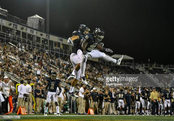 Emmanuel Lubin and Shawndarrius Phillips of the FIU Golden Panthers celebrate a touchdown during the second half against the Indiana Hoosiers at...