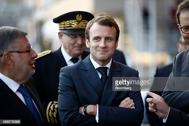 Emmanuel Macron France's economy minister waits before entering the Paris Motor Show on the final preview day in Paris France on Friday Oct 3 2014...