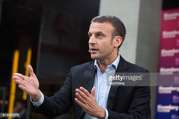 Emmanuel Macron, France's former economy minister, gestures whilst speaking during a Bloomberg Television interview at the Hello Tomorrow technology...