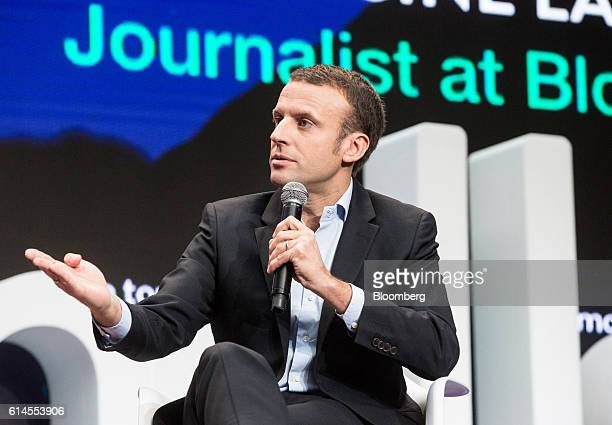 Emmanuel Macron, France's former economy minister, gestures whilst speaking during a panel discussion at the Hello Tomorrow technology conference in...