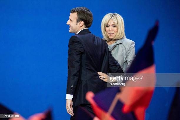 Emmanuel Macron France's independent presidential candidate and his wife Brigitte Trogneux arrive to deliver a speech after the first round of the...