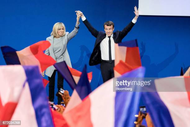 Emmanuel Macron France's independent presidential candidate waves as he arrives with his wife Brigitte Trogneux to deliver a speech after the first...