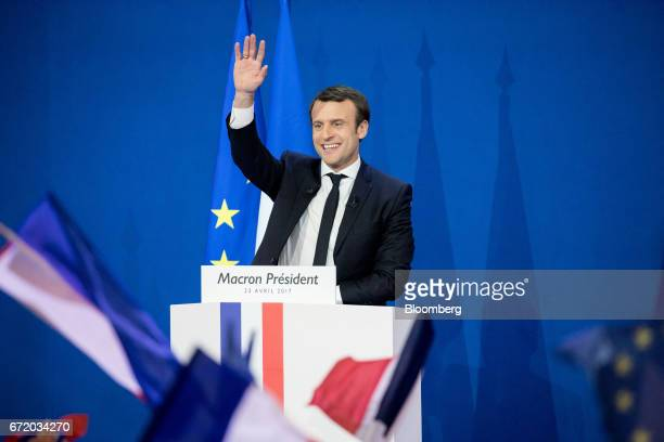 Emmanuel Macron France's independent presidential candidate waves while speaking with attendees after the first round of the French presidential...