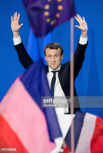 Emmanuel Macron France's independent presidential candidate waves to supporters before delivering a speech after the first round vote projections for...