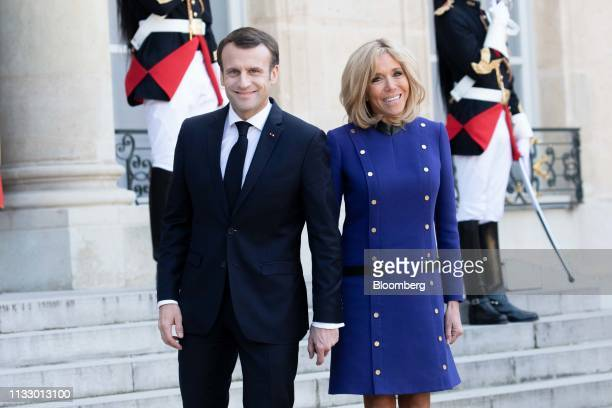 Emmanuel Macron France's president and his wife Brigitte Macron smile following the departure of Xi Jinping China's president not pictured in the...
