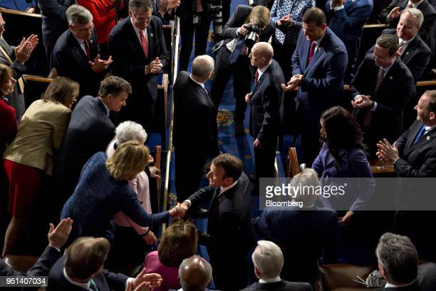 Emmanuel Macron France's president bottom center arrives to a joint meeting of Congress at the US Capitol in Washington DC US on Wednesday April 25...