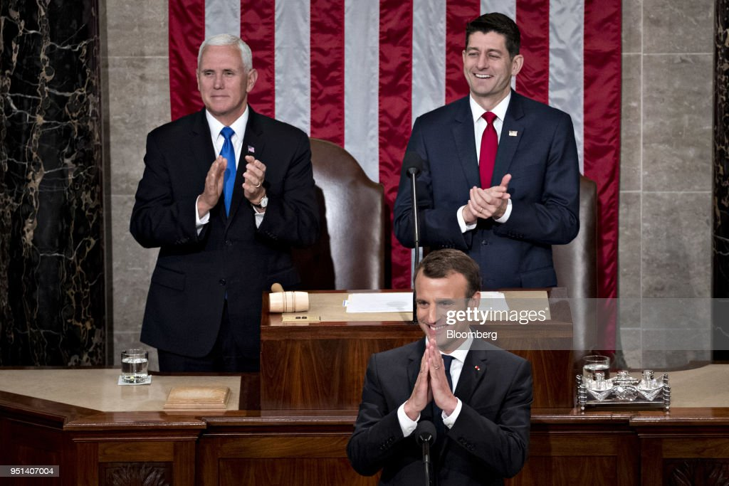 Emmanuel Macron, France's president, center, gestures while arriving to a joint meeting of Congress at the U.S. Capitol in Washington, D.C., U.S., on Wednesday, April 25, 2018. French President Emmanuel Macron arrived in Washington on Monday for a three-day state visit heavy on symbolism, substance and some friendly rivalry with U.S. President Donald Trump. As the two presidents got to know each other we take a look back through the archive at the key moments. Photographer: Andrew Harrer/Bloomberg via Getty Images