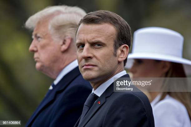 Emmanuel Macron France's president center listens as US President Donald Trump left speaks at an arrival ceremony during a state visit on the South...