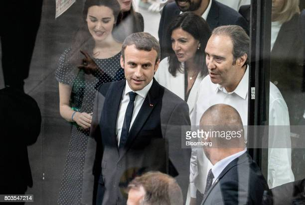 Emmanuel Macron France's president center speaks with Xavier Niel billionaire and cochief operating officer of Iliad SA while arriving for the...