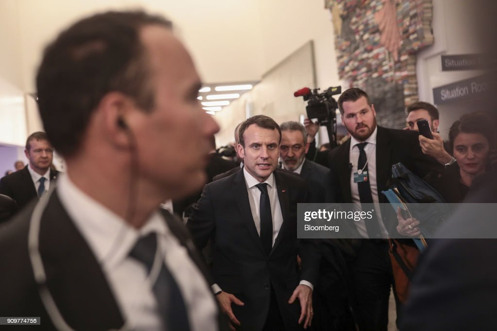 Emmanuel Macron, France's president, center, walks between sessions on day two of the World Economic Forum (WEF) in Davos, Switzerland, on Wednesday, Jan. 24, 2018. World leaders, influential executives, bankers and policy makers attend the 48th annual meeting of the World Economic Forum in Davos from Jan. 23 - 26. Photographer: Simon Dawson/Bloomberg via Getty Images