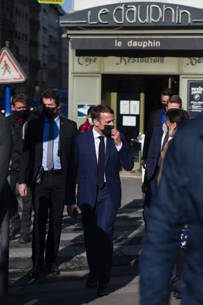 FRA: French President Emmanuel Macron Walks Through Paris' Montmartre District