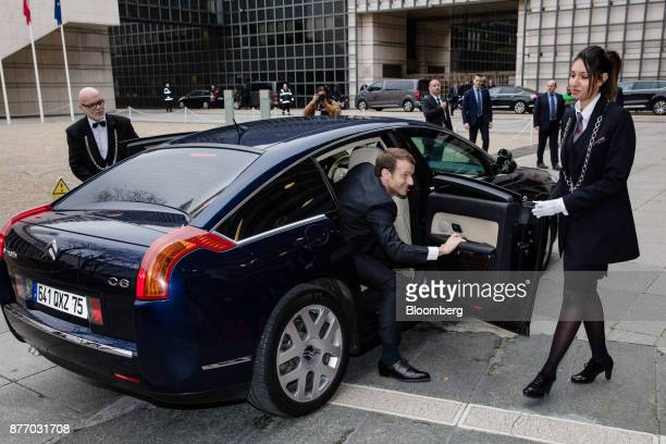 Emmanuel Macron France's president climbs out of a Citroen C6 automobile as he arrives at the Rendezvous de Bercy economic debate at the French...
