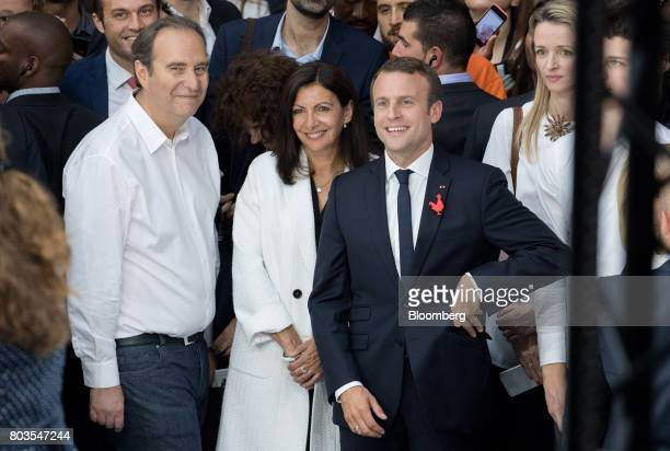 Emmanuel Macron France's president from right Xavier Niel billionaire and cochief operating officer of Iliad SA and Anne Hidalgo mayor of Paris smile...