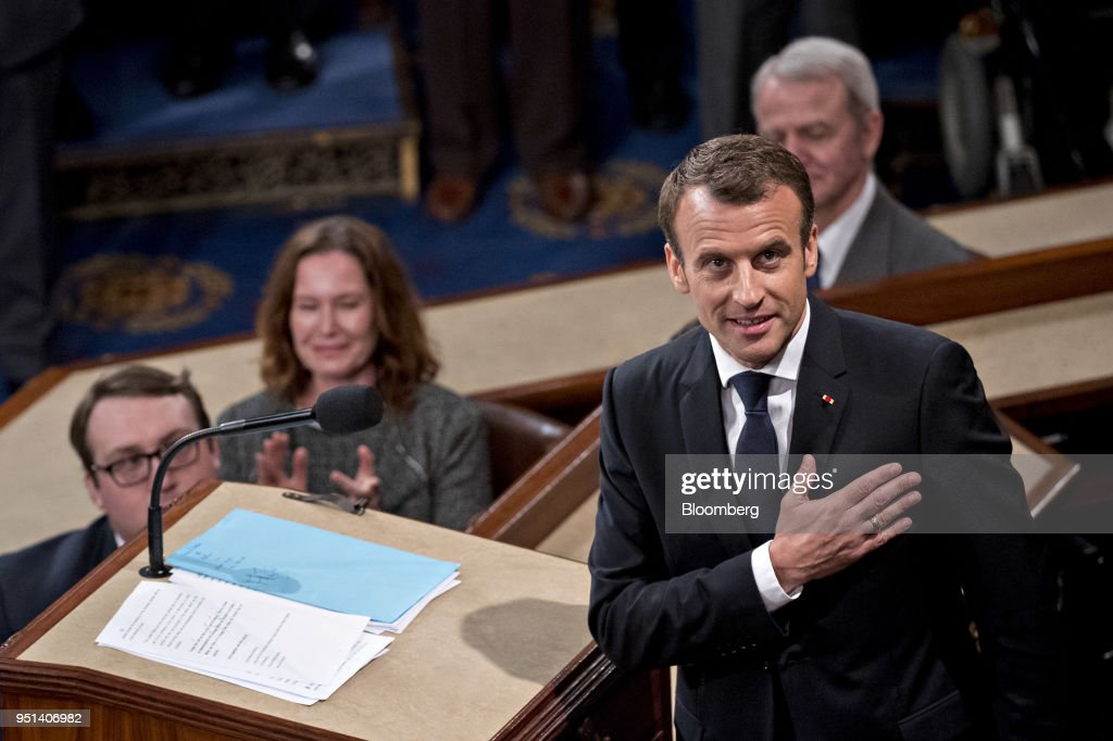 Emmanuel Macron, France's president, gestures after speaking to a joint meeting of Congress at the U.S. Capitol in Washington, D.C., U.S., on Wednesday, April 25, 2018. French President Emmanuel Macron arrived in Washington on Monday for a three-day state visit heavy on symbolism, substance and some friendly rivalry with U.S. President Donald Trump. As the two presidents got to know each other we take a look back through the archive at the key moments. Photographer: Andrew Harrer/Bloomberg via Getty Images