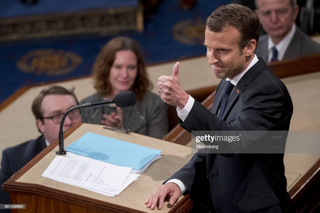 Emmanuel Macron, France's president, gives a thumbs-up after speaking to a joint meeting of Congress at the U.S. Capitol in Washington, D.C., U.S., on Wednesday, April 25, 2018. French President Emmanuel Macron arrived in Washington on Monday for a three-day state visit heavy on symbolism, substance and some friendly rivalry with U.S. President Donald Trump. As the two presidents got to know each other we take a look back through the archive at the key moments. Photographer: Andrew Harrer/Bloomberg via Getty Images