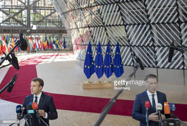 Emmanuel Macron France's president left and Sebastian Kurz Austria's chancellor speak to the media as they arrive for a European Union leaders summit...