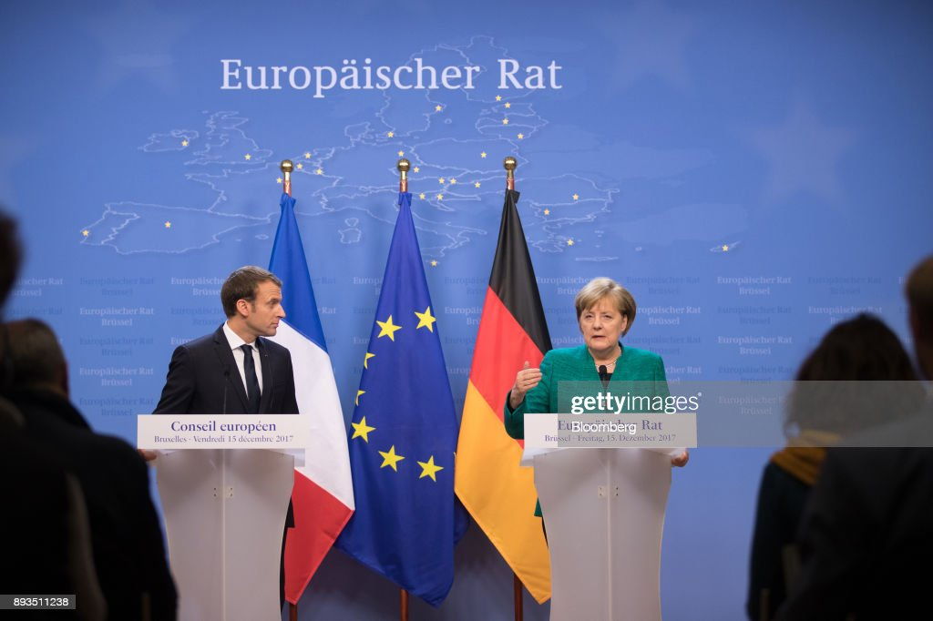 Emmanuel Macron, France's president, left, looks on as Angela Merkel, Germany's chancellor, speaks during a news conference at a summit of 27 European Union (EU) leaders in Brussels, Belgium, on Friday, Dec. 15, 2017. European Union leaders formally agreed that the U.K. has offered enough on the divorce settlement for talks to move on to trade. Photographer: Jasper Juinen/Bloomberg via Getty Images