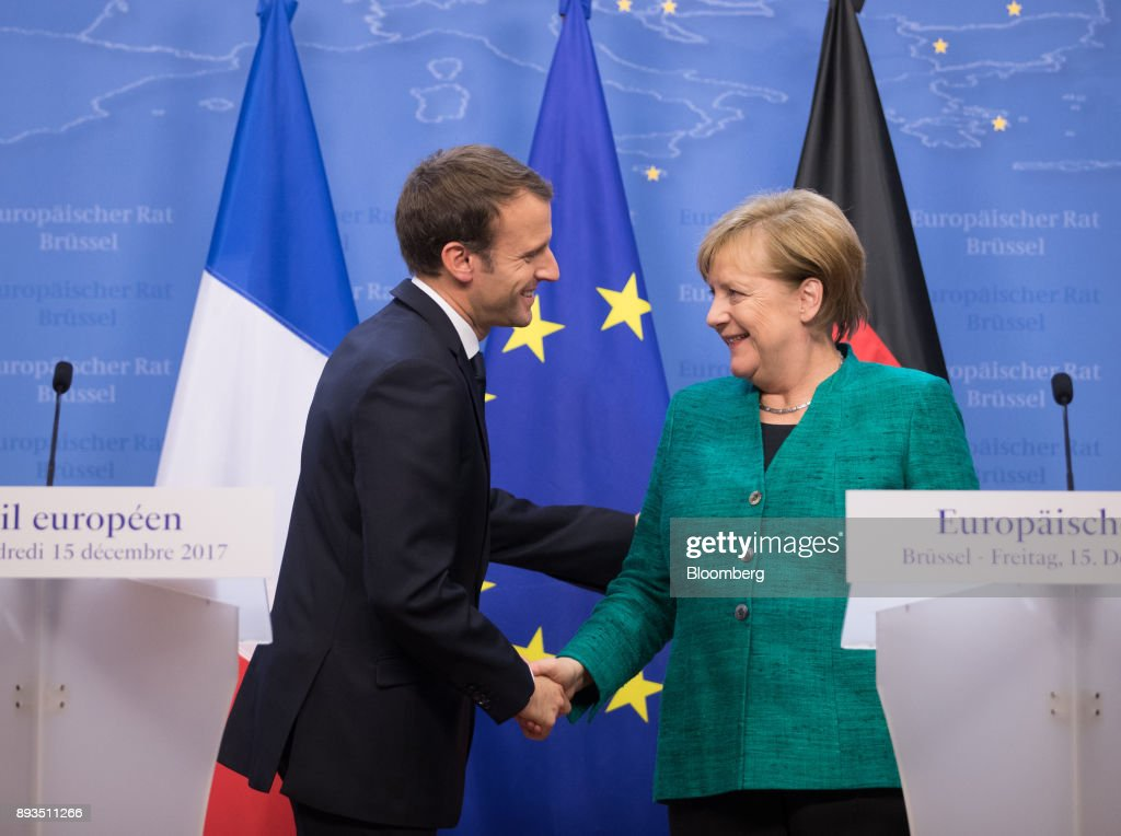 Emmanuel Macron, France's president, left, shakes hands with Angela Merkel, Germany's chancellor, at the end of a news conference at a summit of 27 European Union (EU) leaders in Brussels, Belgium, on Friday, Dec. 15, 2017. European Union leaders formally agreed that the U.K. has offered enough on the divorce settlement for talks to move on to trade. . Photographer: Jasper Juinen/Bloomberg via Getty Images