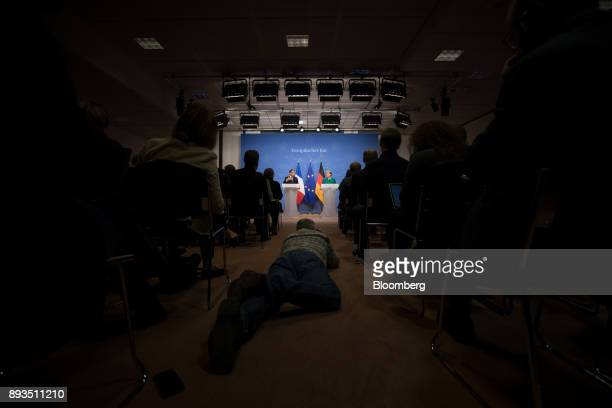 Emmanuel Macron France's president left speaks as Angela Merkel Germany's chancellor looks on during a news conference at a summit of 27 European...