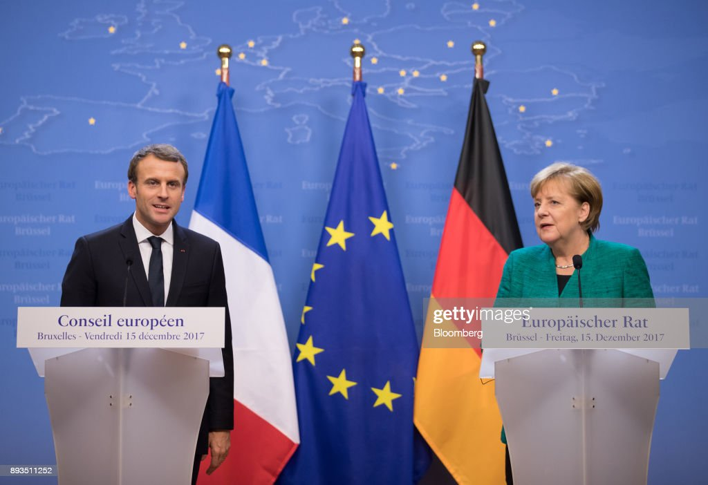 Emmanuel Macron, France's president, left, speaks as Angela Merkel, Germany's chancellor, looks on during a news conference at a summit of 27 European Union (EU) leaders in Brussels, Belgium, on Friday, Dec. 15, 2017. European Union leaders formally agreed that the U.K. has offered enough on the divorce settlement for talks to move on to trade. Photographer: Jasper Juinen/Bloomberg via Getty Images