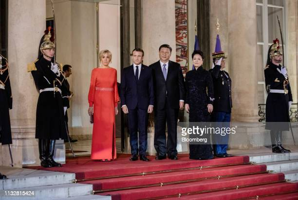 Emmanuel Macron France's president second left and his wife Brigitte Macron left stand for a photograph with Xi Jinping China's president second...