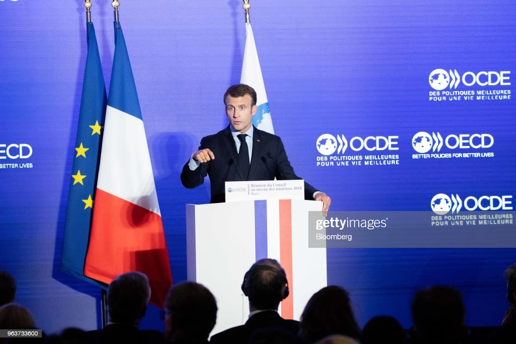 Emmanuel Macron, France's president, speaks at the Organisation for Economic Co-operation and Development (OECD) forum in Paris, France, on Wednesday, May 30, 2018. President Donald Trump's unilateral tariff measures are necessary to fix a broken global trade system and the U.S., like other nations, should focus on its own interests, according to Commerce Secretary Wilbur Ross. Photographer: Christophe Morin/Bloomberg via Getty Images