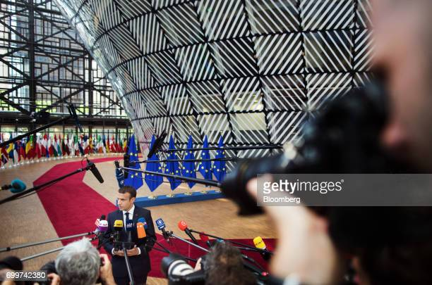 Emmanuel Macron France's president speaks to the media as he arrives for a European Union leaders summit at the Europa building in Brussels Belgium...