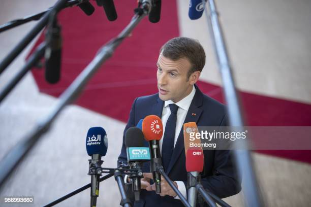 Emmanuel Macron France's president speaks to the media as he arrives for a European Union leaders summit in Brussels Belgium on Friday June 2018 EU...