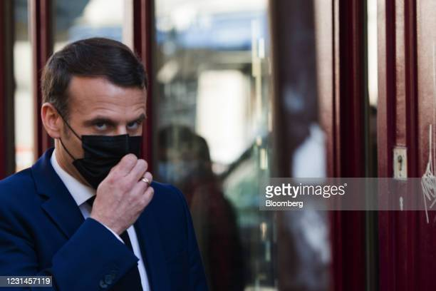 Emmanuel Macron, Frances president, wears a protective face mask while walking in the Montmartre district in Paris, France, on Monday, March 1, 2021....